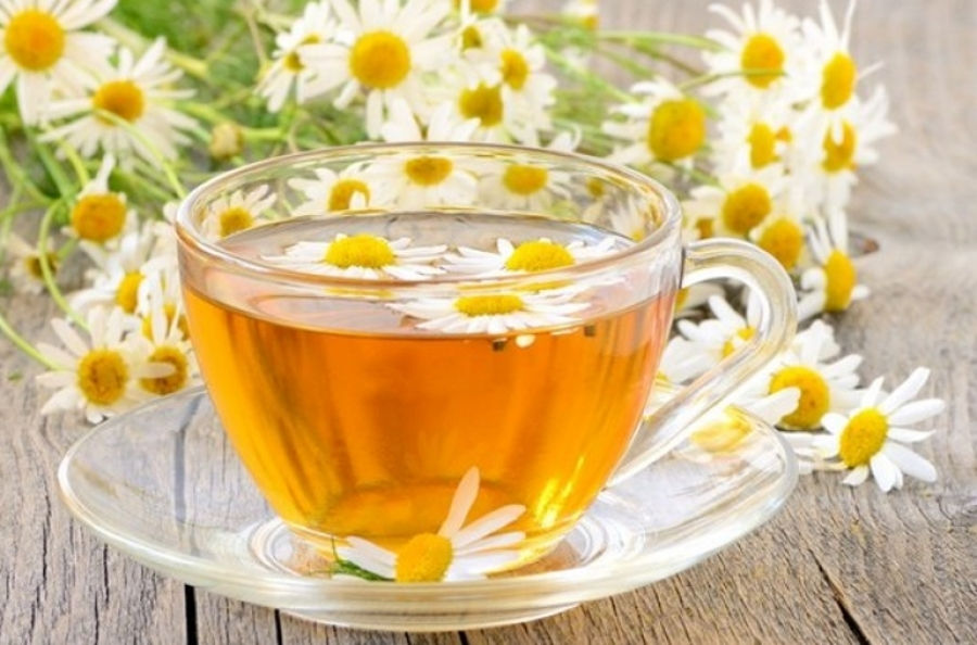 Glass cup with a camomile tea royalty free stock wallpaper - gallery tea with a camomile royalty free stock photo